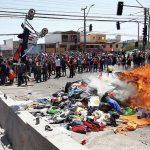 PDI detiene a tres personas por incendiar pertenencias de ciudadanos venezolanos en Iquique